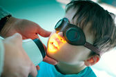 Close up portrait of a cute little boy during medical treatment — Stock Photo
