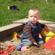 Girl in sand-pit — Stock Photo