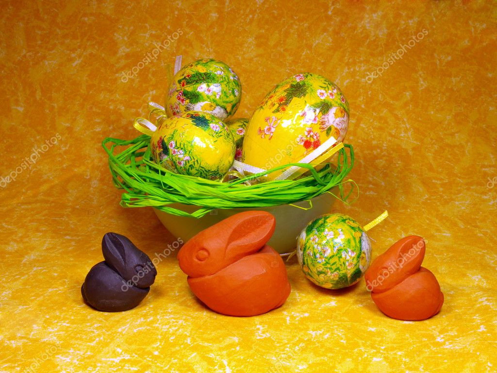 Easter decoration with eggs and ceramic bunnies  Stock Photo #7631027