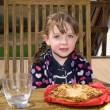 Girl and potato pancake — Stock Photo
