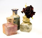 Dirty bottles with rose — Stock Photo