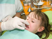 Girl stressed by dental examination — Stok fotoğraf