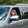 Young lady in car — Stock Photo