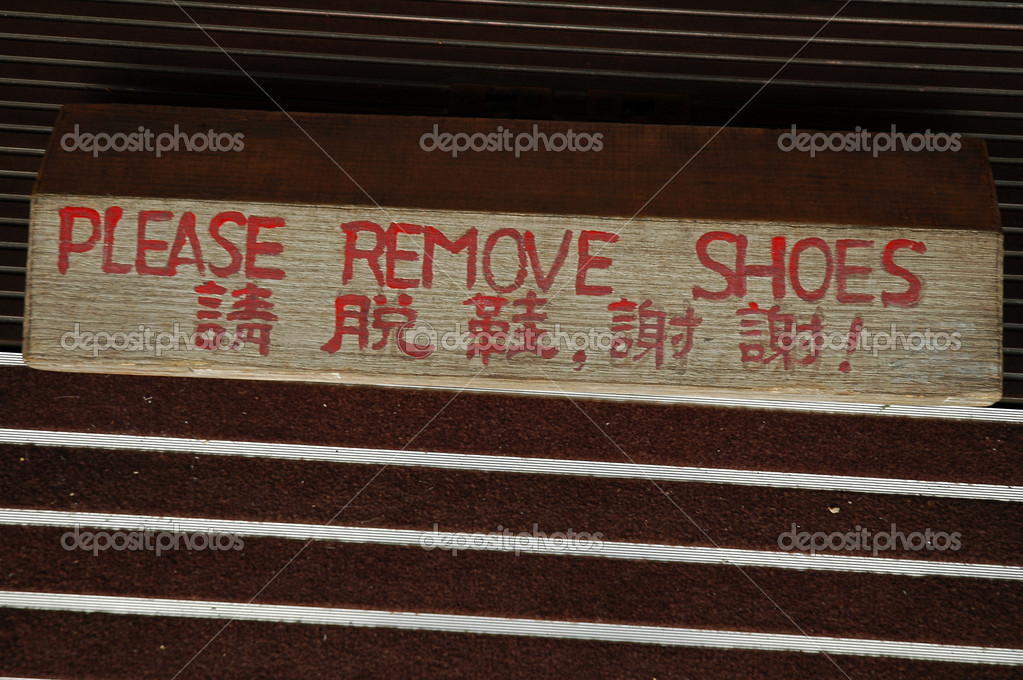 Entrance to buddhist temple, sign with translation — Foto de Stock   #7626279