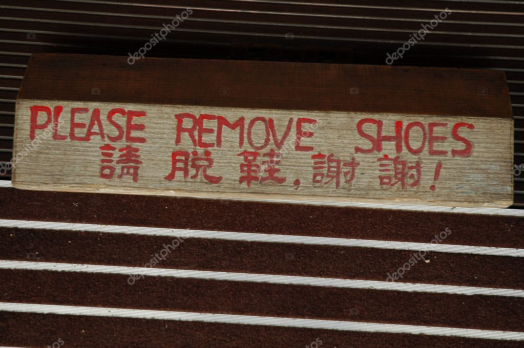 Entrance to buddhist temple, sign with translation  Stock fotografie #7626279