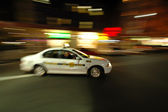 Cab in motion — Stock Photo
