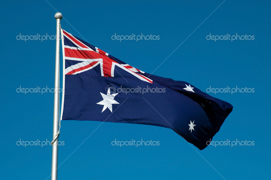 Waving australian flag, clear blue sky background,  Stock Photo #7891457
