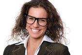 Beautiful smiling woman wearing glasses — Stock Photo