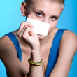 Stock Photo: Portrait of beautiful girl holding blank notecard.