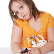 The little girl with a cellular telephone — Stock Photo
