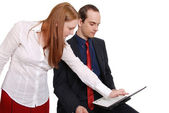 Two happy businesspeople working together — Stock Photo
