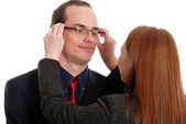 Young woman tries on glasses to the businessman — Stock Photo
