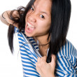 The Asian girl tears a frock — Stock Photo #7650158