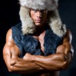 Strong athletic man in a fur cap — Stock Photo #7650247