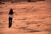 Woman walking in the desert — Stock Photo