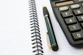Note book with calculator and pen — Stock Photo