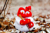 Christmas snowmen with a gift — Stock Photo