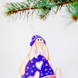 Wooden toy on a fur-tree branch — Stock Photo