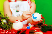 The girl decorates New Year's balls — Stock Photo