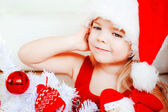 The little girl in santa hat — Stock Photo