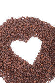 Heart shape coffee beams on white — Stock Photo