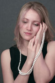 Girl with beads — Stock Photo