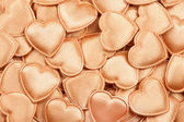Gold hearts background — Stock Photo