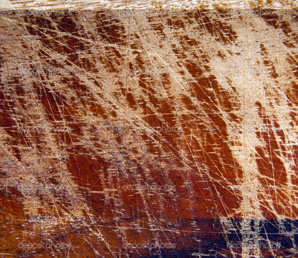 Detail of a wooden chopping board with scratches all over — Stock Photo #7691533
