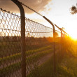 Stock Photo: Sunset Fence
