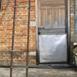 Ladder and Door - Stockfoto