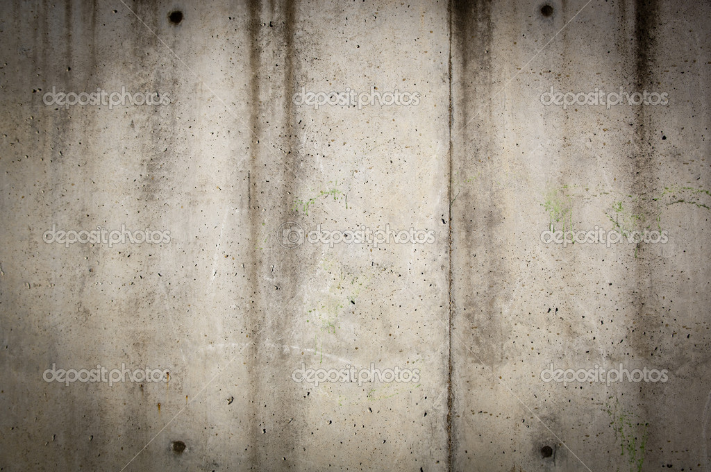 Tall concrete wall in rough, gunge style with stains and wear — Stock Photo #7707410
