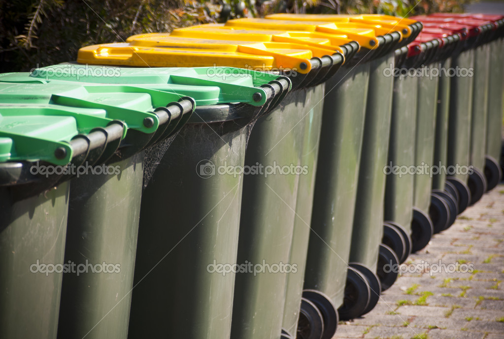 Row of large green wheelie bins for rubbish — Stock Photo #7708818