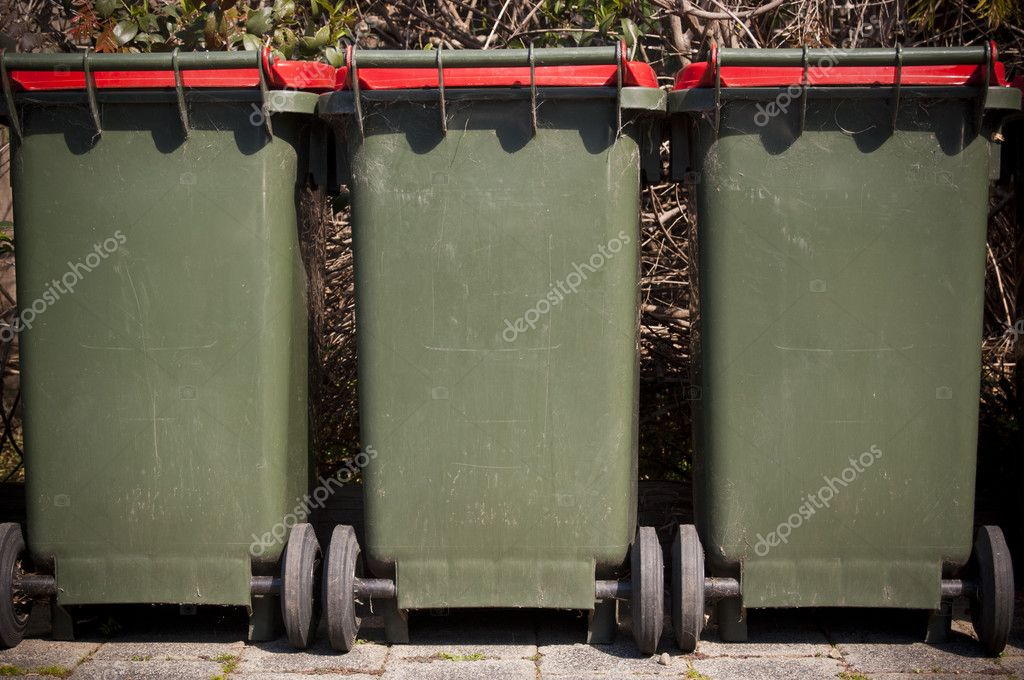 Row of large green wheelie bins for rubbish — Stock Photo #7708837