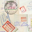 Stock Photo: Passport Stamps Background