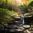 Small Waterfall with Sun beams — Stock Photo