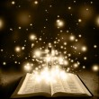 Glowing Bible with Cross on Brown Backround - Stock Photo