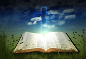 Glowing Bible with Cross — Stock Photo