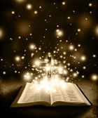 Glowing Bible with Cross on Brown Backround — Stock Photo