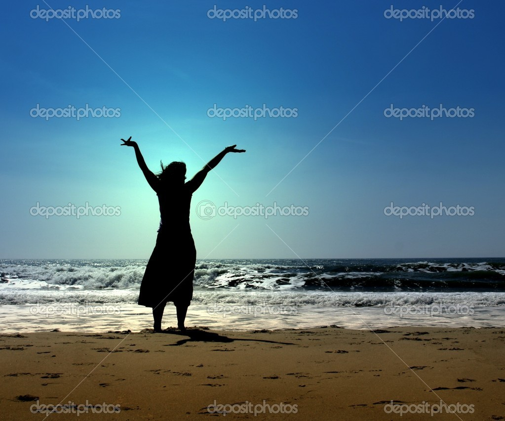 A woman praising with beach in the background — Stock Photo #7768455