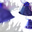 Three Christmas bells with bows — Stock Photo