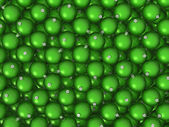 Green Christmas balls background — Photo