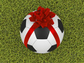 Soccer ball with ribbon — Stock fotografie