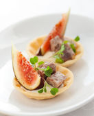 Appetizer with fig and pate — Stock Photo