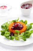 Camembert with cranberry sauce — Stock Photo