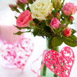 Vase of roses and hearts - Stock Photo