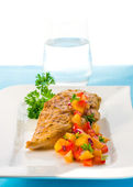 Chicken with mango salsa — Stock Photo