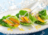 Chicken salad on lettuce leaves — Stock Photo