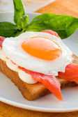 Fried egg with salmon — Stock Photo
