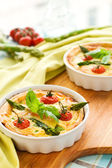 Tomato asparagus quiche — Stock Photo