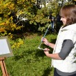 Stock Photo: Charming artist in park